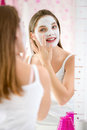 Beauty Girl Getting Facial Mask Royalty Free Stock Image - 47975716
