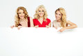 Attractive Blond Ladies Holding Board Royalty Free Stock Photos - 47980708