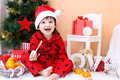 Happy Little Boy In Santa Hat With Lollipop And Presents Stock Image - 47984161