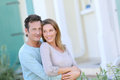 Happy Middle-aged Couple Standing In Front Of Their New Home Royalty Free Stock Photo - 47990195