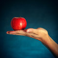 Red Apple On The Hand Royalty Free Stock Image - 47990746