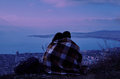 Couple In Love Sitting On Hill Above The City In Night Stock Photos - 48018833