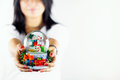 Blurry Woman Holds Snowman Sphere Stock Photography - 48019392