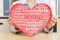 Hands Holding Heart With Charity Tag Cloud Stock Images - 48042624