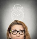 Business Woman With Alarm Clock Above Her Head Royalty Free Stock Photos - 48052888
