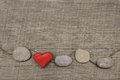 One Red Heart With Stones On Wooden Background. Royalty Free Stock Photography - 48059147