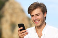 Handsome Young Man Using A Mobile Phone Outdoor Royalty Free Stock Photo - 48067105