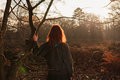 Woman Admiring Sunset In Forest Royalty Free Stock Image - 48087396