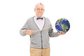 Teacher Pointing On The Earth With A Stick Royalty Free Stock Photos - 48095448
