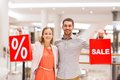 Happy Young Couple With Red Shopping Bags In Mall Stock Images - 48144674