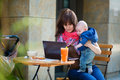 Young Mother With Her Baby Boy Working In Cafe Royalty Free Stock Photo - 48159285