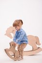 Child With The Toy Horse Stock Image - 48202641