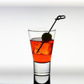 Short Drink Glass With Red Liquid, Olive, Ice Cubes Royalty Free Stock Images - 48217329