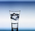 Short Drink Glass With Clear Liquid And Ice Cubes Royalty Free Stock Photos - 48217508