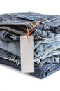Pile Of Blue Jeans With Tag Label. Royalty Free Stock Photo - 48255715