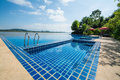 Swimming Pool Near Khong River With Blue Sky Royalty Free Stock Photography - 48286537