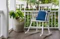 White Wooden Rocking Chair On Front Porch At Home Royalty Free Stock Image - 48331476