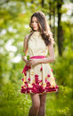 Young Beautiful Girl In A Yellow Dress In The Woods. Portrait Of Romantic Woman In Fairy Forest. Stunning Fashionable Teenager Royalty Free Stock Image - 48374546