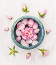 Pink Rose Flower In Blue Bowl On White Wooden Background With Bud Stock Image - 48376991