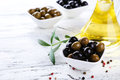 Green And Black Olives In Bowl On A White Wooden Background Royalty Free Stock Photo - 48382875