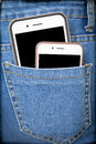 Cell Phones In Back Pocket Of Girl S Jeans Royalty Free Stock Images - 48420379