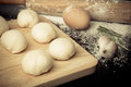 Dough On A Board With Flour. Olive Oil, Eggs, Rolling Pin, Garli Royalty Free Stock Photo - 48434545