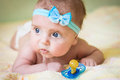 A Little Child Holds A Pacifier In His Hand Stock Photography - 48471082