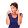Charming Lady Gesturing A Phone Call Stock Photography - 48474762