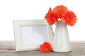 Orange Gerbera Flowers And Photo Frame On Wooden Table Royalty Free Stock Photography - 48565067