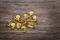 Gold Tablets Of Vitamin E. On A Texture. Stock Photos - 48594463
