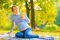 Young Pregnant Woman With Pear In The Park Royalty Free Stock Photography - 48597127