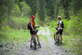 Two Womens On Bikes In Spring Forest Royalty Free Stock Photo - 4869785