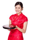 Chinese Woman Hold Snack Tray For New Year Royalty Free Stock Images - 48600799