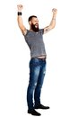 Excited Handsome Tattooed Bearded Man With Arms Raised Stock Image - 48602061