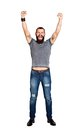 Excited Handsome Tattooed Bearded Man With Arms Raised In Succes Royalty Free Stock Photography - 48602067
