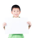 Smiling Boy Standing With Empty Horizontal Blank Paper In Hands Isolated On White Background Stock Photo - 48617370