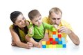 Kid With His Parents Play Building Blocks Stock Image - 48627261