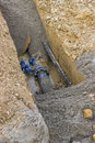 Hole In The Ground With Water Pipe Royalty Free Stock Photo - 48633335