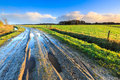 Rural Landscape With Wet Road And Grassland Royalty Free Stock Images - 48637589