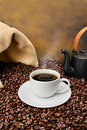 Coffee Cup Close-up Over Roasted Beans Royalty Free Stock Photos - 4871148