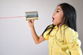 Little Girl Using A Can As Telephone Royalty Free Stock Image - 48723796
