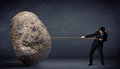 Businessman Pulling Huge Rock With A Rope Stock Image - 48736991