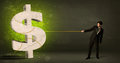 Business Man Pulling A Big Green Dollar Sign Stock Image - 48737001