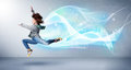 Cute Teenager Jumping With Abstract Blue Scarf Around Her Royalty Free Stock Image - 48737776