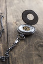 Pocket Watch On Grunge Wooden Table Stock Photo - 48740080