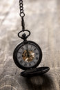 Pocket Watch Over Grunge Wooden Table Royalty Free Stock Image - 48740106