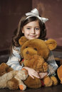 Girl With Teddy Bears Royalty Free Stock Photography - 48748387