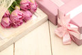 Flowers And Gift Box On Wooden Background Royalty Free Stock Image - 48750246