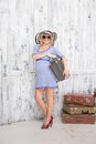 Pregnant Tourist With Suitcases Stock Photography - 48754242