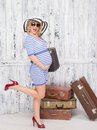 Pregnant Tourist With Suitcases Stock Photo - 48754260